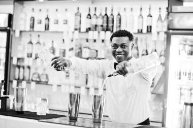 African american bartender working behind the cocktail bar. Alco