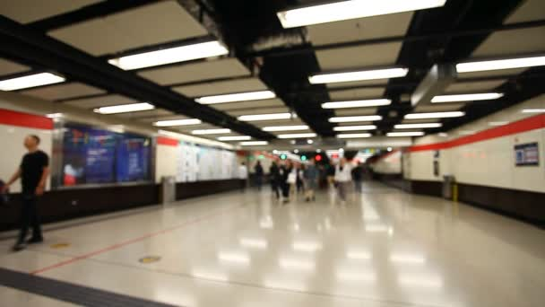 blurred movement of people in subway
