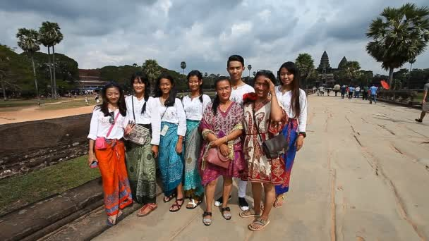 Siam Reap, Cambodia - January 12, 2017: A group of Cambodians on the background of the main entrance of Angkor Wat.