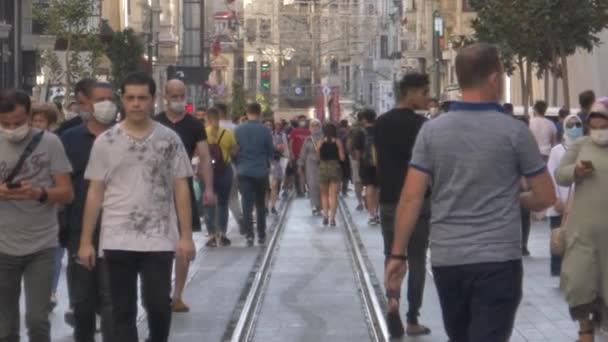 Istanbul / Turkey - 08-05-2020  corona virus. covid 19. new normal life istanbul. crowded street. masked people. Street walking, shopping.