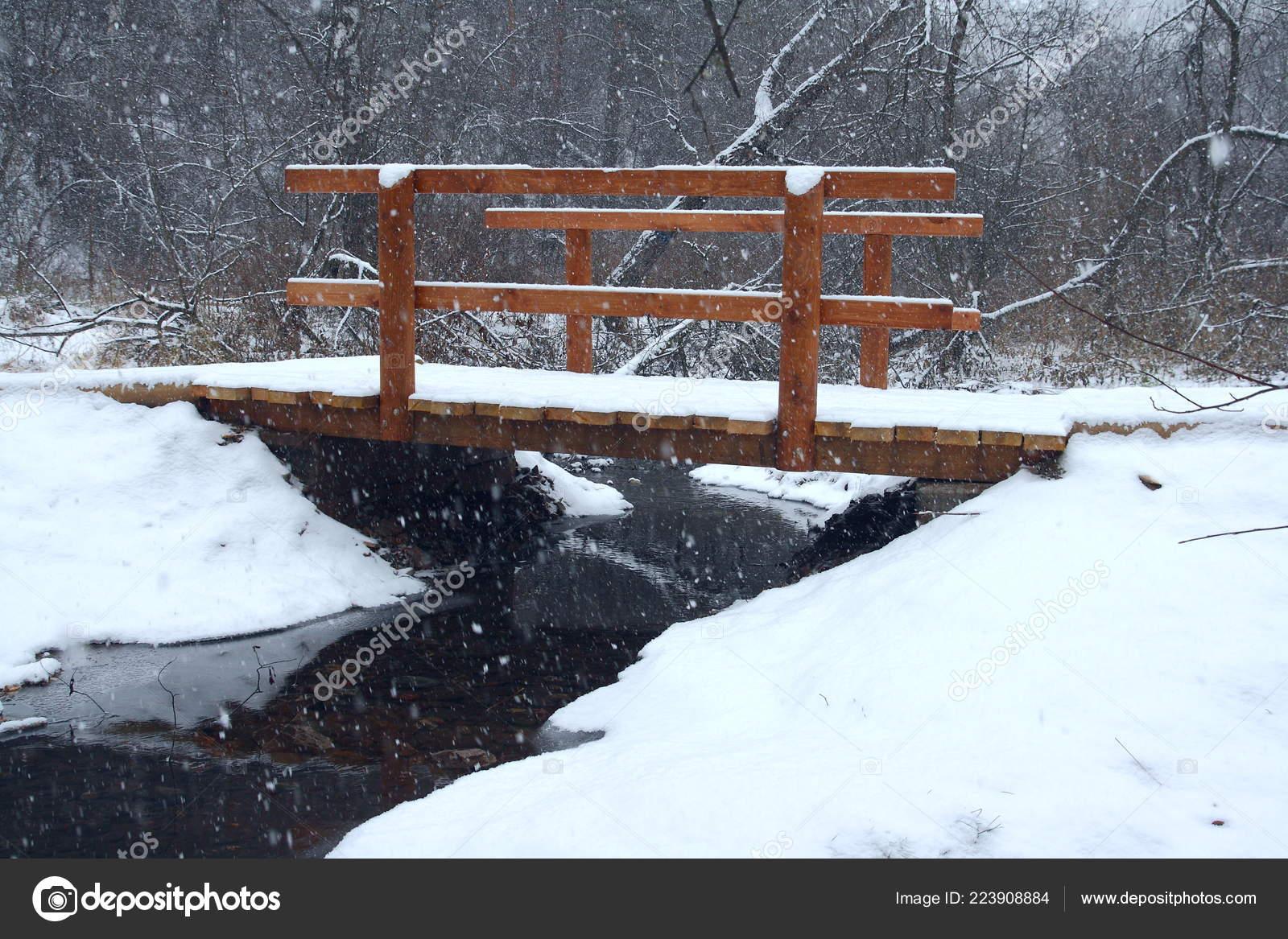 Winter Landscape A Small Wooden Bridge Over The Stream Stock
