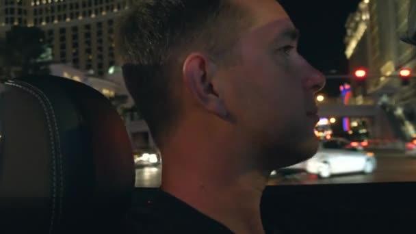 Man in a car in Las Vegas.
