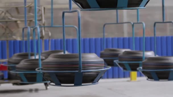 Conveyor with tires at factory. Tires production.