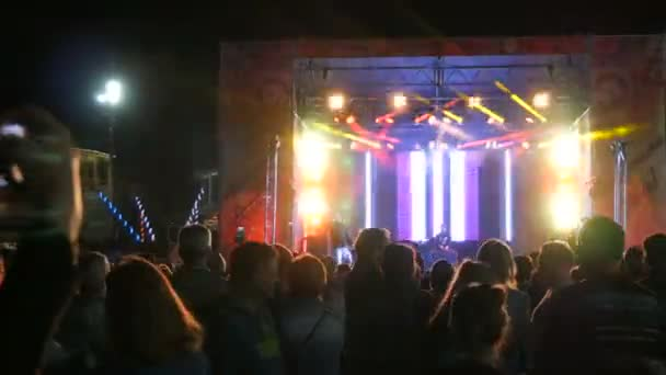 Yalta, Crimea - May 1, 2018: Cheerful disco in the open air, a crowd of people dancing, an incendiary DJ leads a party. A lot of people are dancing at a concert