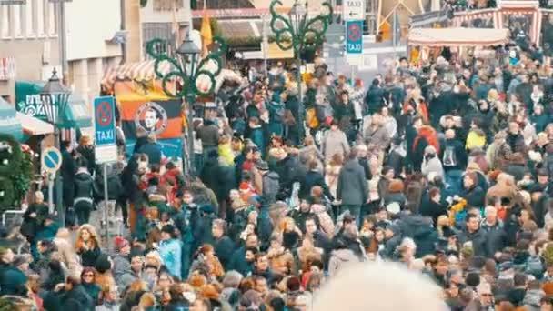 Nuremberg, Germany - December 1, 2018: A crowd of people walking around Christmas market in Europe