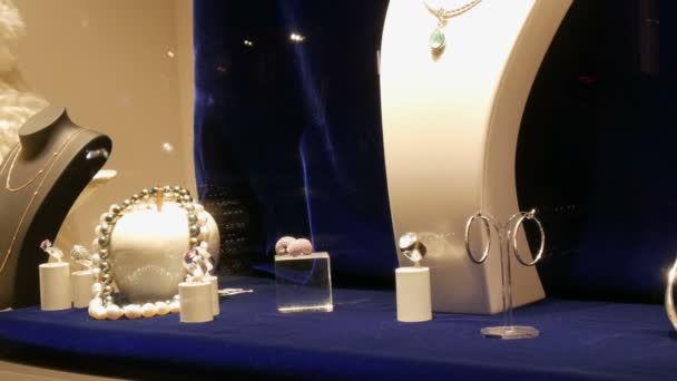 Counter with expensive luxury jewelry made of gold, silver, pearls in the window of jewelry store