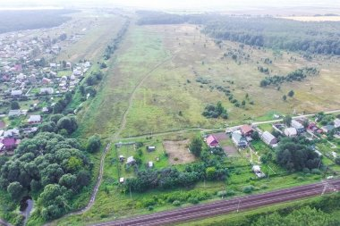 Top view of the village, fields and forests near the village