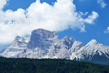 Monte Civetta mountains at daylight. Clouds on background. Province of Belluno in northern Italy