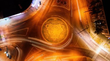 Chisinau city at night from aerial drone view with moving cars. Roundabout long exposure