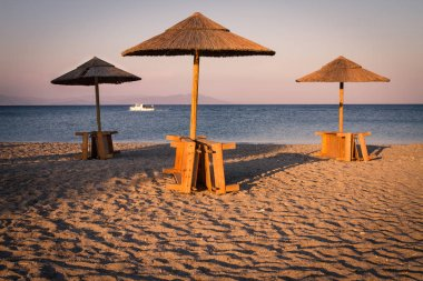 Beach and sea view with sunshades at sunset chillout
