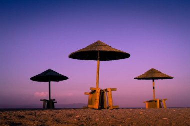 Beach and sea view with sunshades at sunset chillout color split toning