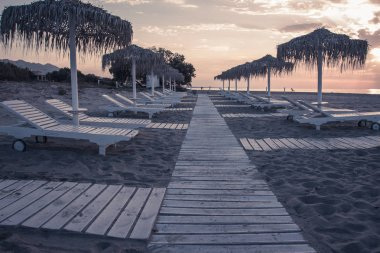 Hotel resort beach sea view with sunshades at sunset chillout color split toning