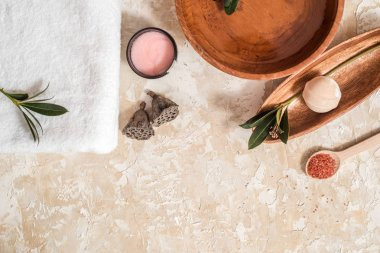 set for spa. pink salt, scrub with rose petals, white towel on a bright white background. The concept of cleanliness, health and spa treatments. Free Text Space, Flat Lay Style