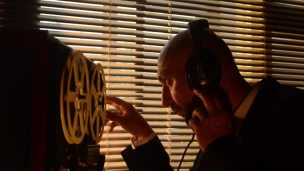 Secret special agent listens to the conversation, recording on a reel-to-reel