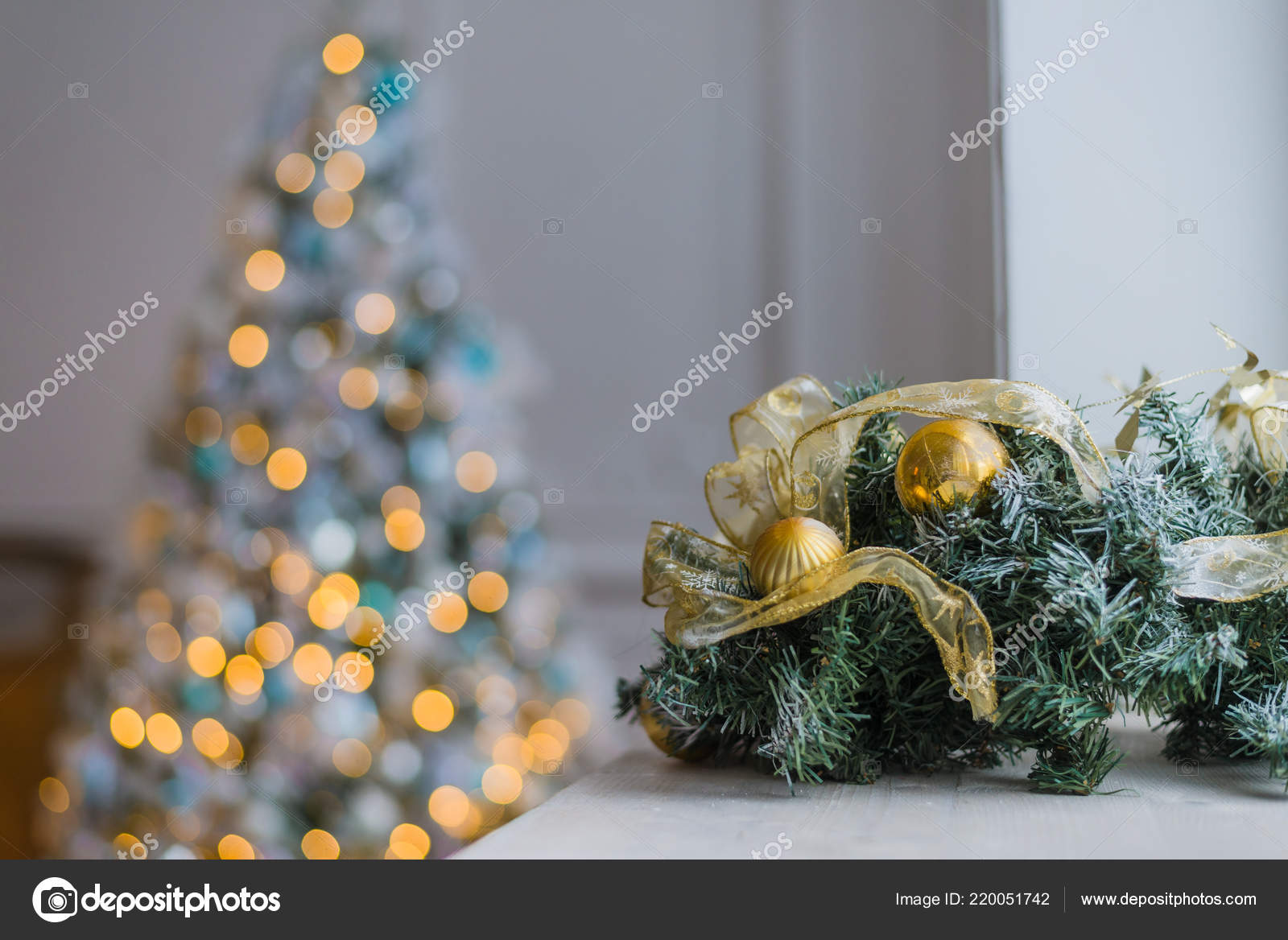 Gold Christmas Background Of De Focused Lights With Decorated Tree Photo By Romankosolapov