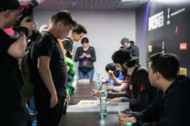 MOSCOW, RUSSIA - OCTOBER 27 2018: EPICENTER Counter Strike: Global Offensive esports event. Team Avangar players on autograph session with a fans.