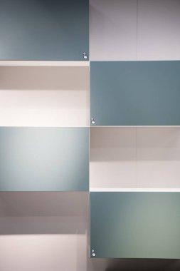 Light blue closet lockers close up background texture modern design. Push sign on it
