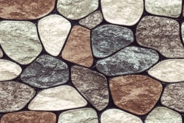 Wall round stone rock texture and seamless background. pale color of the stones. Marble texture