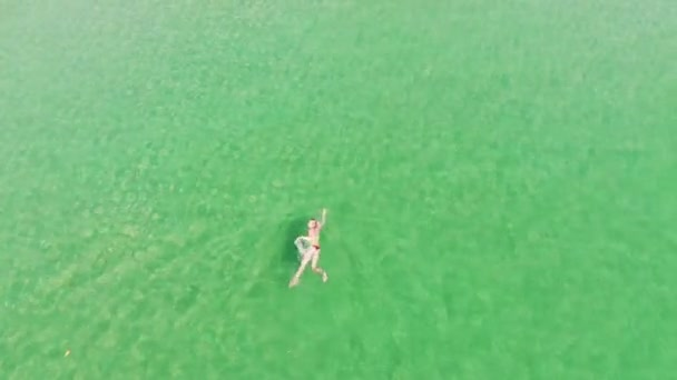 Top view woman in clear and transparent sea water. Aerial view woman in turquoise sea water. Paradise beach with crystal clear water
