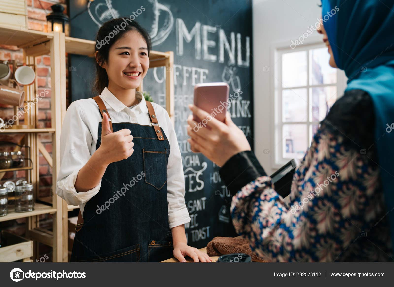 Girl waitress staff ok good thumb up hand sign — Stock Photo