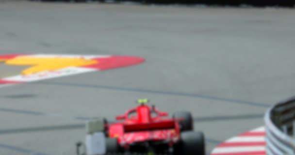 Červené formuli jedna rasa na rychlosti trati v pomalém pohybu - abstraktní pohybu pozadí - 4 k Video
