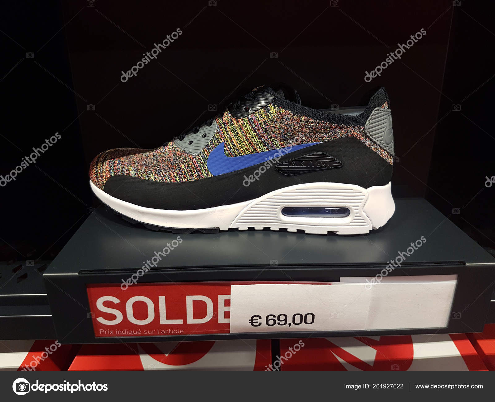 quality design 0d640 5bfe3 Villefontaine, France - July 29 2018 Multicolor Nike Air Max Shoe On  Display in Nike Outlet Store at The Village Outlet Shopping, Sale Price  Sign in French ...