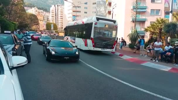 Monte-Carlo, Monaco - April 21, 2018: 3 Luxurious Sports Cars : Ferrari 488 GTB, McLaren 650 S  Porsche GT3 Driving Around the Fairmont Famous Hairpin Turn in Monte-Carlo, Monaco in The French Riviera - 4K Video
