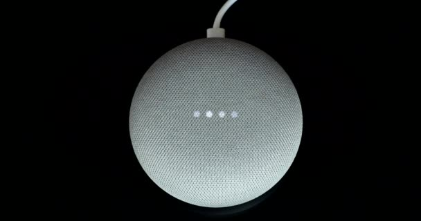 Paris, France - December 17 2018: Overhead View Of A Google Home Mini With Cable (Chalk Color), Black Background. Smart Speaker With The Google Assistant, Virtual Assistant Powered By Artificial Intelligence - DCi 4K Resolution
