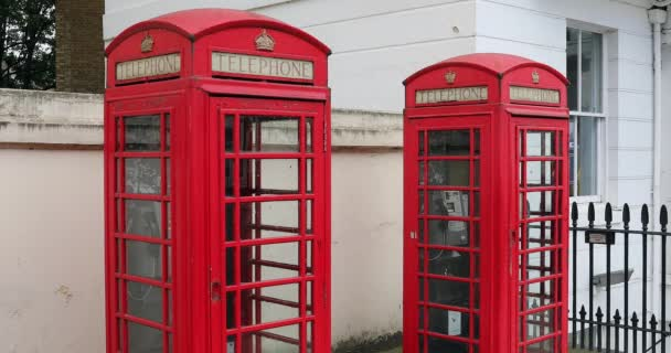 London, UK, May 28, 2019: Two Red British Telephone Boxes On Belgrave Road In London United Kingdom, British Icon, City Center Of London - DCi 4K Resolution