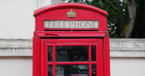 London, UK, May 28, 2019: Typical Red Telephone Box On Belgrave Road In London United Kingdom, British Icon In The City Center Of London - Close Up View - DCi 4K Resolution