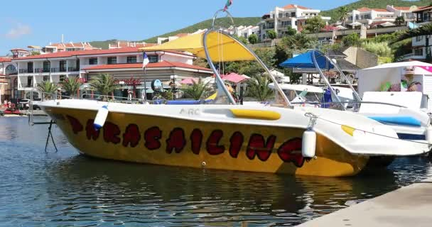 Sveti Vlas, Bulgaria - August 11, 2019: Colorful Yellow Parasailing Boat, Mercan Yachting Motor Boat Parked In The Port Of Sveti Vlas In Bulgaria, Europe. Close Up View - DCi 4K Video