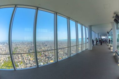 Osaka, Japan - April 30, 2017: large windows inside observation deck of viewing platform of a top of Osakas Abeno Harukas, the tallest skyscraper in Japan.