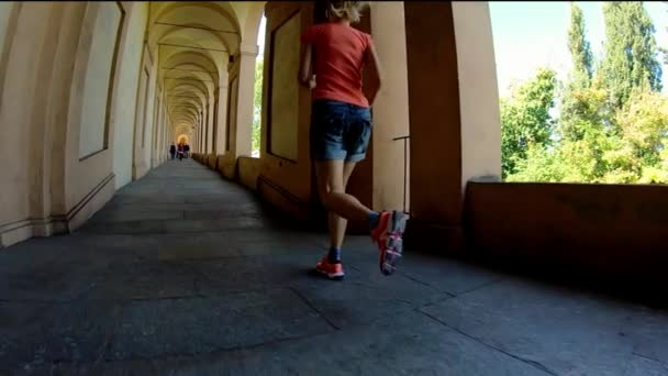 woman running under porch