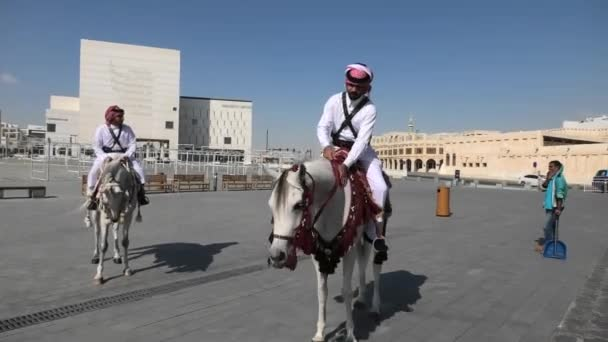 Police riding in Souq Waquif