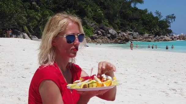 Woman with tropical fruit