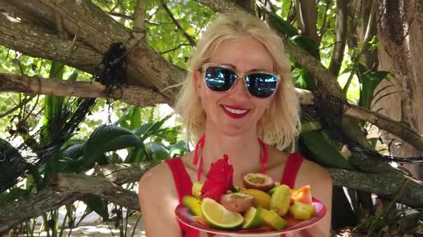 Woman with tropical fruit dish