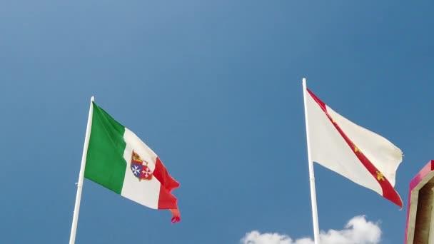 Italian flag and Elba island flag