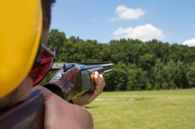 Man shooting on an outdoor shooting range stock vector