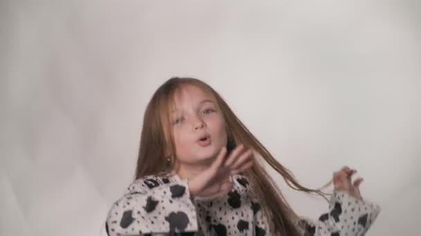 Happy little girl fluttering hair.