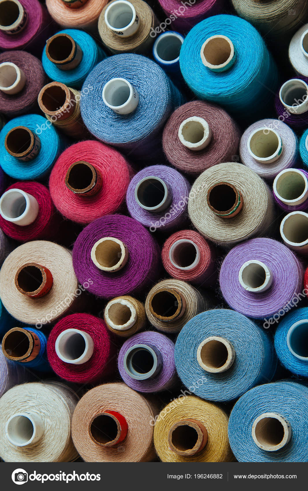 b371afd26b191 A set of threads of different colors. Many threads for sewing and  needlework are different in color and size. Multicolored palette of  threads.– stock image