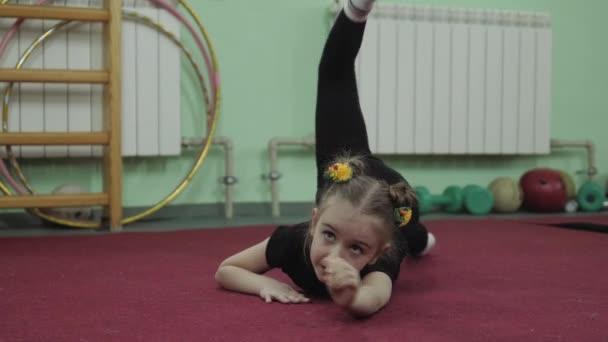 little girl in gymnastics. Gymnastics exercise in 4K