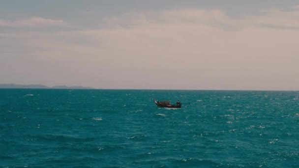 view of small fishing boat floating in the sea