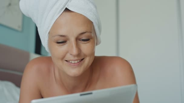 Happy woman having video chat using tablet pc camera