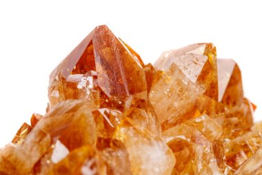 Macro mineral stone Citrine in rock in crystals on a white background close up