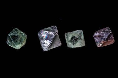 macro mineral fluorite stone on balck background