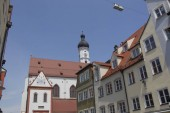 Fotografie Residential buildings in a narrow old town street in the city of Landsberg