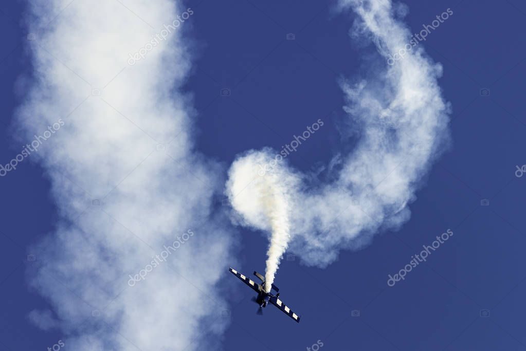 Airplane acrobatics in air show.
