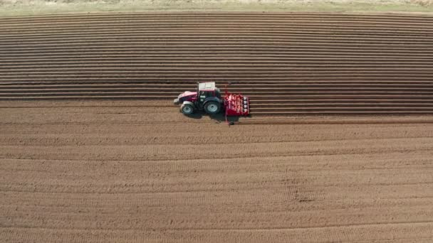 Tractor with disc harrows on the farmland