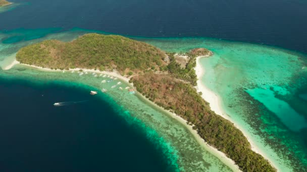 torpical island with white sandy beach, top view.