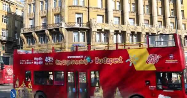 BUDAPEST, HUNGARY - JANUARY 15, 2019 : Street scene and city traffic with red double decker touristic bus on Budapest